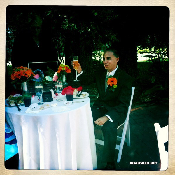 Mike cheers at sweetheart table
